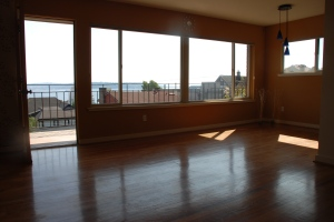 hardwood floors and a long balcony